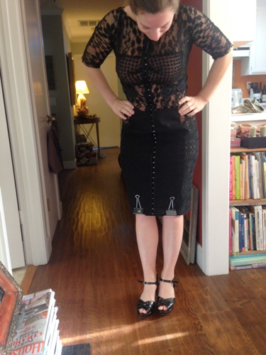 Checking out the fit of a hand-me-down dress on Caitlin