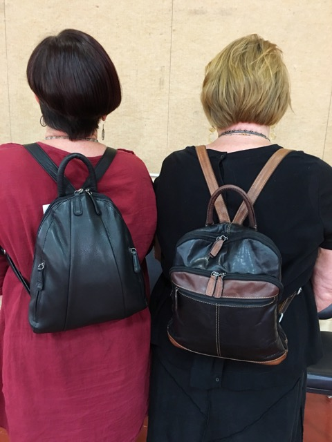 Wearing backpacks at the gem faire