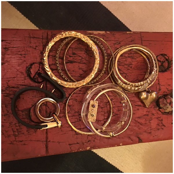 A collection of gold bangles on Brenda Kinsel website