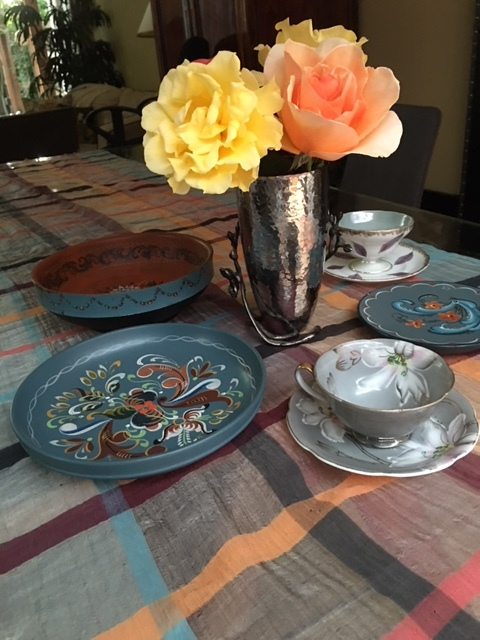 """Everything looks familiar, right Mom? The rosemaling and your teacups and your yellow roses."""