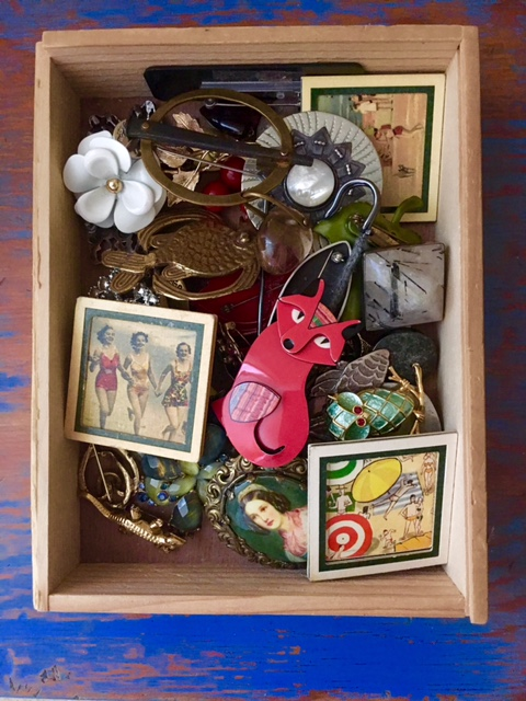 Brooches stored in wooden box