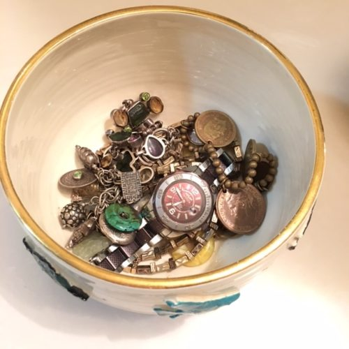 Charm bracelets stored in fish bowl