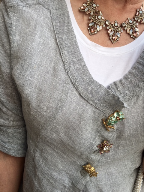 Owl pins become buttons on a sweater