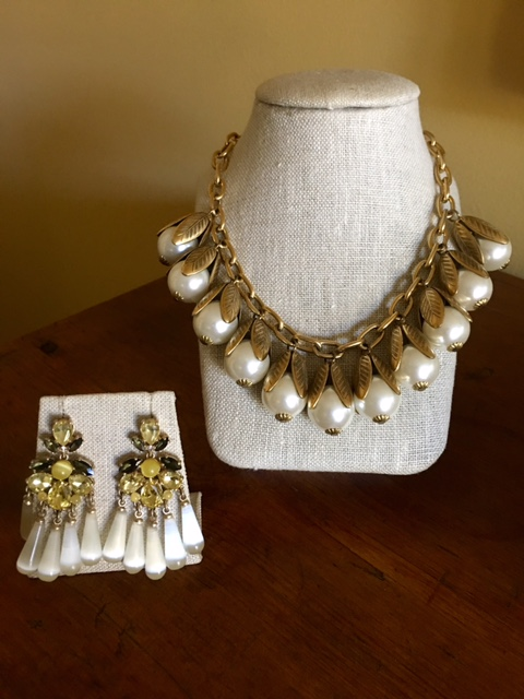 Earrings and pearl necklace