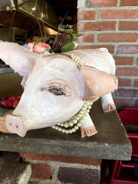 A pig and pearls