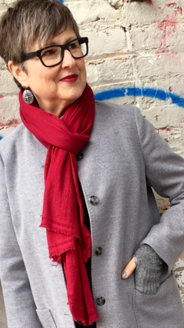 Raspberry scarf on coat