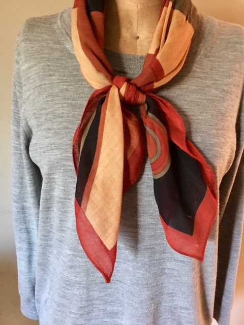 Deco scarf over gray Tippi sweater by J.Crew