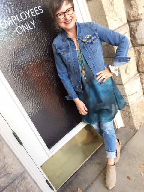 Jean jacket over dress and jeans