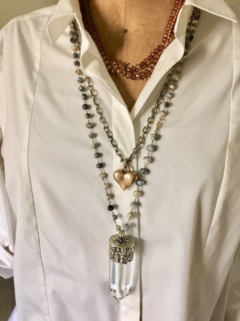 Wearing a group of three necklaces