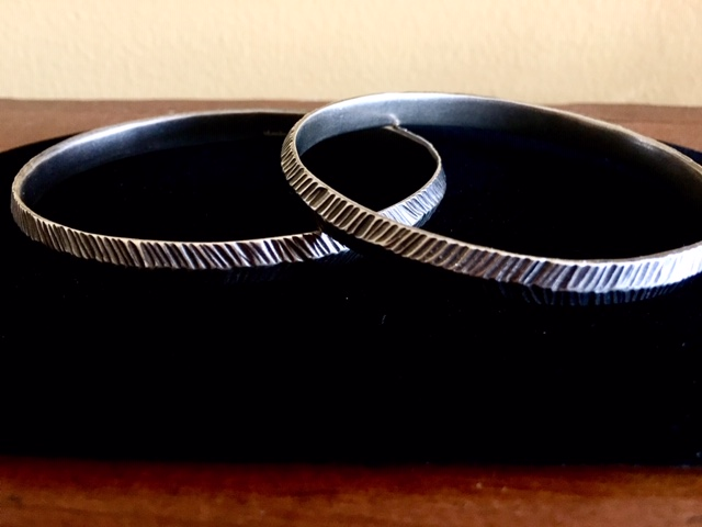 Silver bangles by Kendra Renee